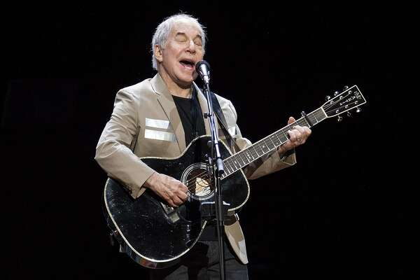 FILE - In this May 16, 2018 file photo, Paul Simon kicks off his Homeward Bound: The Farewell Tour in Vancouver, British Columbia. Simon, who's 76, isn't retiring. He has a disc due out this fall and promises he'll still occasionally appear on stage. Since he started writing songs as a teen-ager, it's hard to imagine that impulse shutting off forever. He�s done with the idea of long concert tours, so if you live in Greensboro, Austin or Orlando and want to see him perform, this is it. (Jimmy Jeong/The Canadian Press via AP)