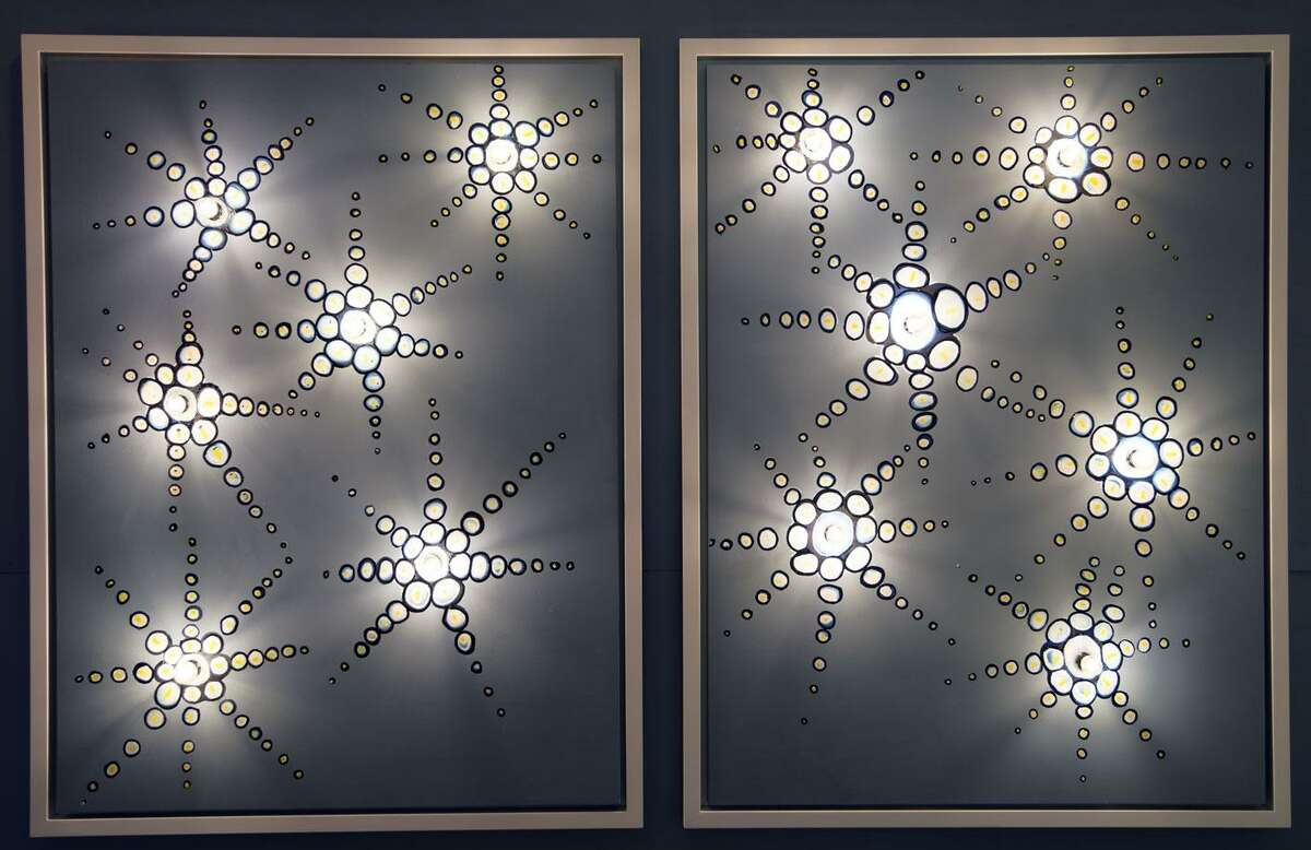 Westport artist Cris Dam has begun a series of illuminated works. He uses marquee lights and utilizes the background paint as a way to enhance the play of light and shadows on the canvas.