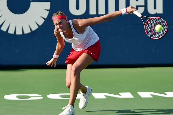 Czech Petra Kvitova defeats fellow Czech Lucie Safarova, 6-7, 6-2, 6-2, Saturday, August 28, 2015 for the Connecticut Open championship at the Connecticut Tennis Center at Yale in New Haven. (Catherine Avalone/New Haven Register)