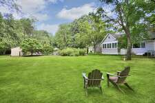 The level property of just over one acre has ample lawn for games and relazation.