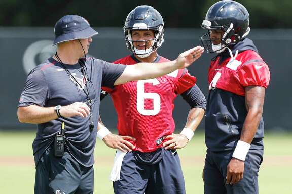 Houston Texans NFL football head coach Bill O'Brien, left, works with quarterbacks Stephen Morris (6) and Deshaun Watson (4) during practice in Houston, Tuesday, May 22, 2018. (Brett Coomer/Houston Chronicle via AP)