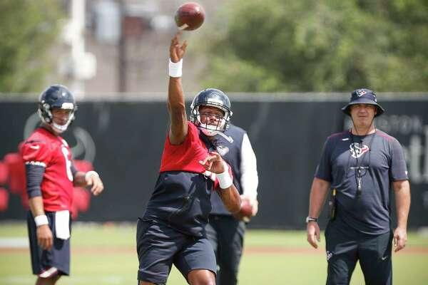 Houston Texans quarterback Deshaun Watson throws a pass during Organized Team Activities at The Methodist Training Center on Tuesday, May 22, 2018, in Houston.