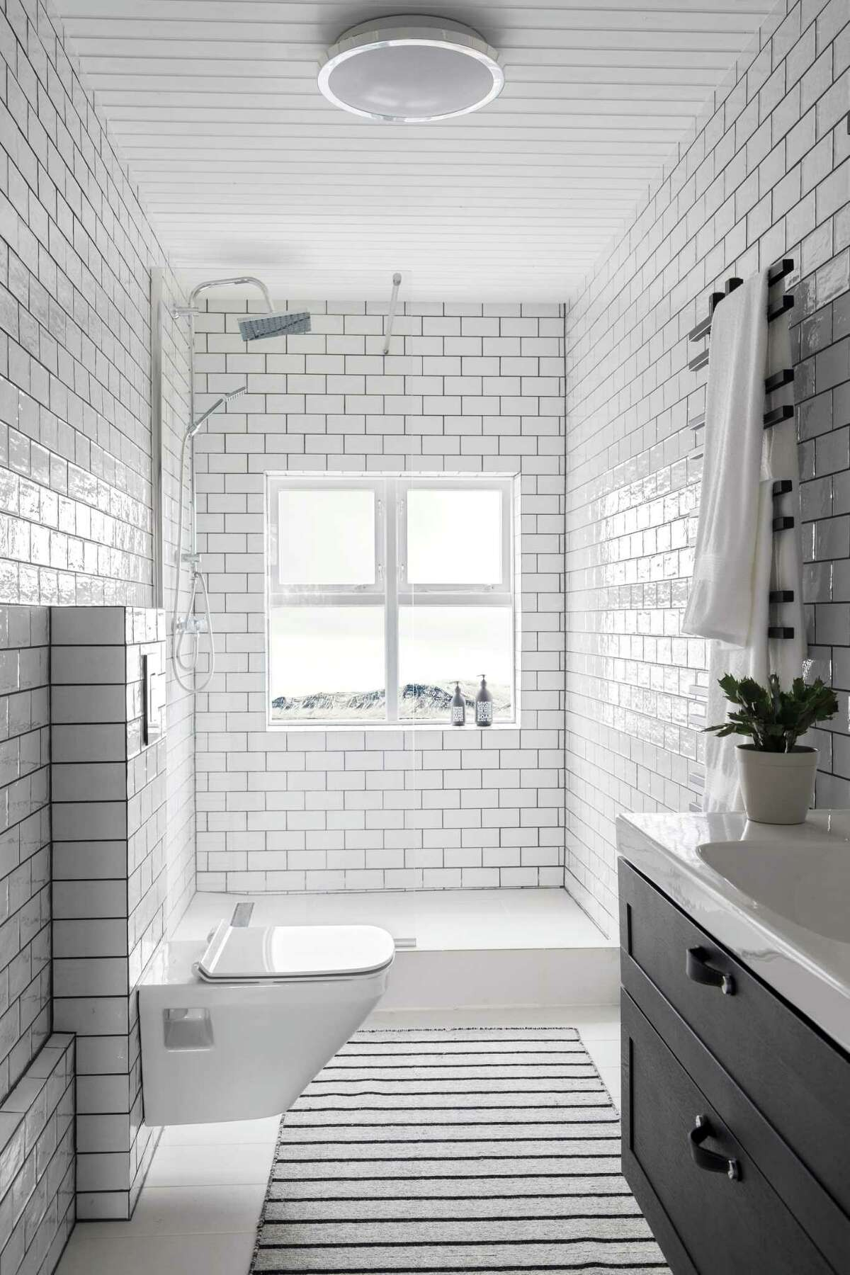White subway tile is a bathroom mainstay because it is so versatile. In lieu of white grout, a pale gray grout adds just enough contrast for interest.