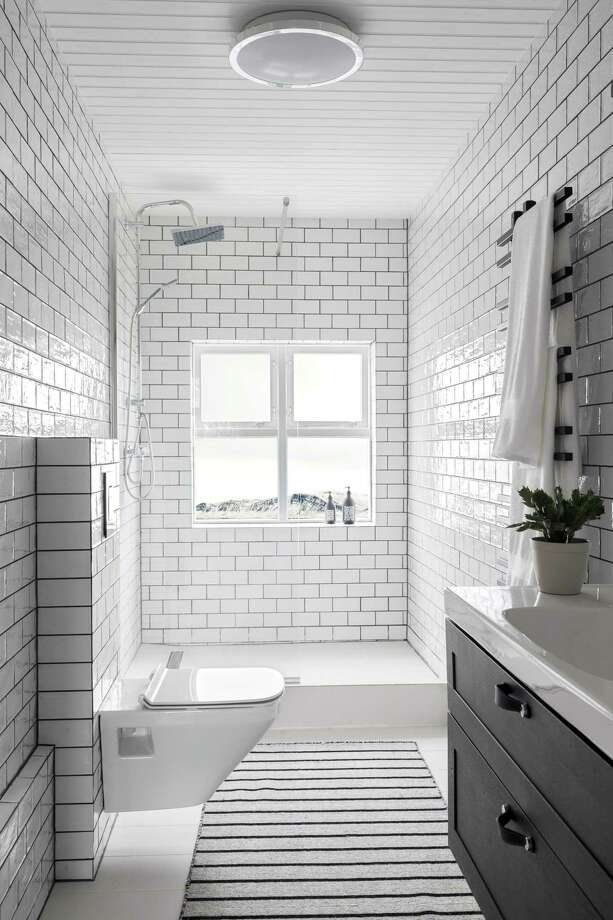 White subway tile is a bathroom mainstay because it is so versatile. In lieu of white grout, a pale gray grout adds just enough contrast for interest. Photo: Rustic White Photography / Contributed Photo / © Rustic White Photography  www.rusticwhitephotography.com