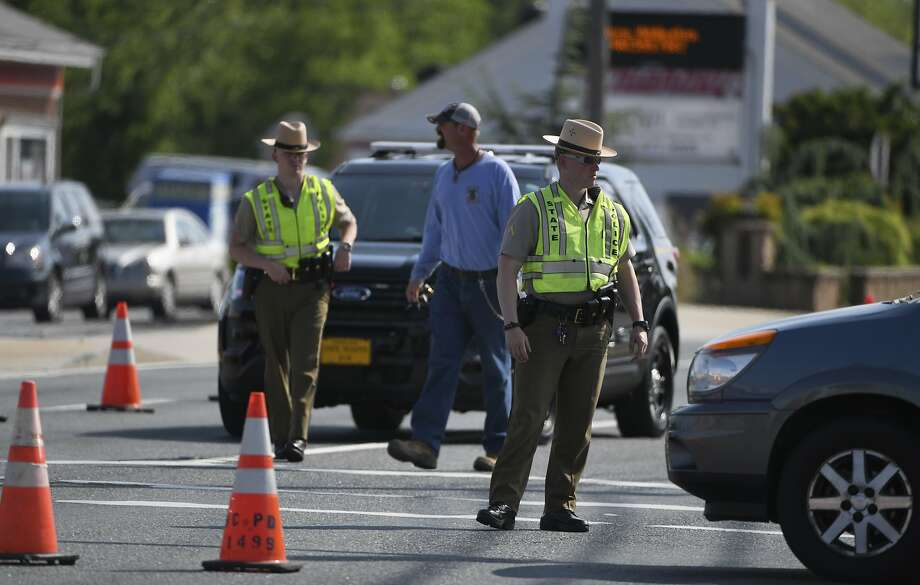 Maryland State Police divert traffic after Baltimore County officer Amy Caprio (above) was killed in Perry Hall, Md. Photo: Jerry Jackson / Associated Press