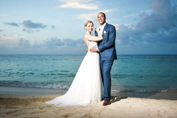 Talk about an incredible wedding photo! KENS noon anchor Aaron Wright and his bride, Katie, enjoyed seaside nuptials with family, friends at Sandals resort in Jamaica.