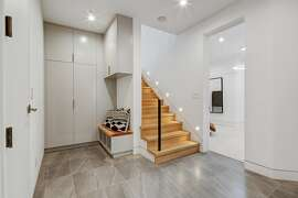 The lower level offers a tile entryway leading to a hardwood staircase.
