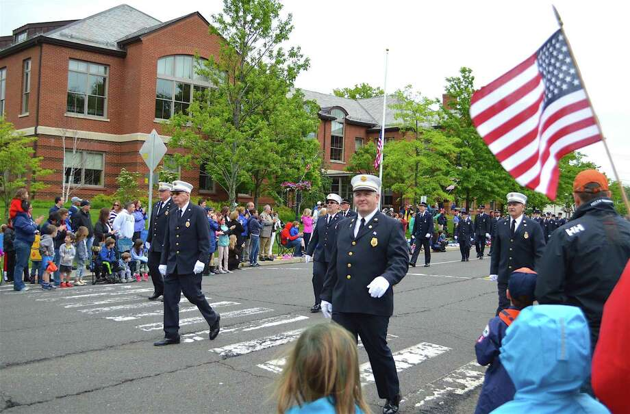 Men in uniform march up the Post Road at the annual Memorial Day celebration, Monday, May 29, 2017, in Darien, Conn. Photo: Jarret Liotta / For Hearst Connecticut Media / Darien News Freelance