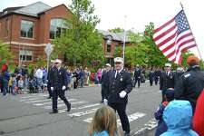 Men in uniform march up the Post Road at the annual Memorial Day celebration, Monday, May 29, 2017, in Darien, Conn.
