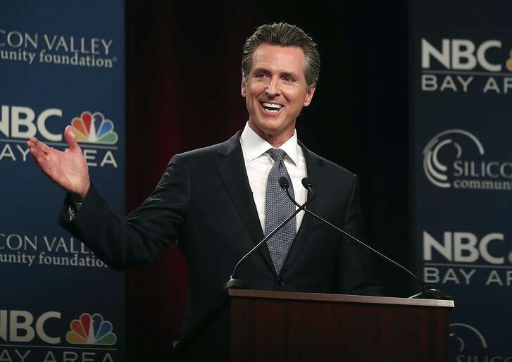 FILE - In this May 8, 2018, file photo, Democratic gubernatorial candidate Gavin Newsom speaks during a debate at the California Theatre in San Jose, Calif. Charter school advocates are far outpacing teachers unions in spending to support candidates for California governor and state schools chief. Teachers unions have dropped about $4 million on committees to back Newsom for governor and Tony Thurmond for superintendent. (Aric Crabb/San Jose Mercury News-Bay Area News Group via AP, Pool, File)