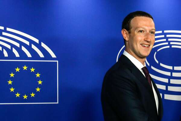 Mark Zuckerberg, chief executive officer and founder of Facebook Inc., smiles as he arrives to testify at the European Union (EU) parliament in Brussels, Belgium, on Tuesday, May 22, 2018. Zuckerberg will tout the company's investment in Europe and again take responsibility for privacy failures, according to testimony prepared for an appearance Tuesday in front of the region's parliament. Photographer: Dario Pigantelli/Bloomberg