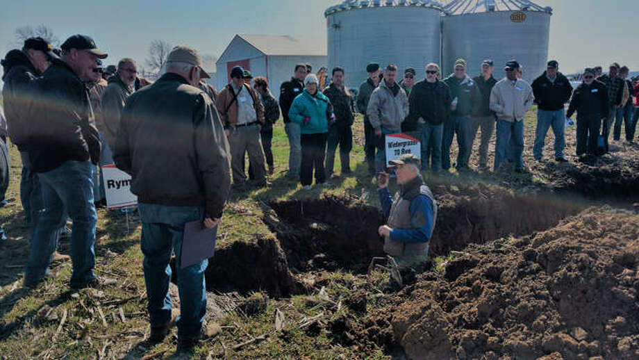 Madison County farmers learn about soil health in Highland with local soil consultant Jerry Berning. Photo:       For The Telegraph