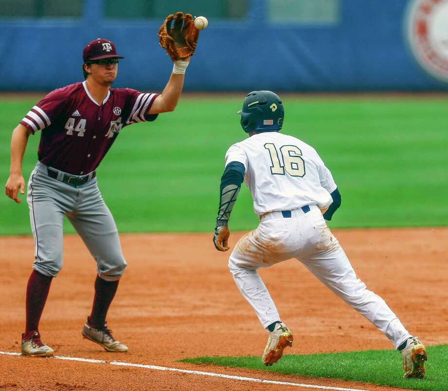 Texas A&M infielder George Janca (44) catches a throw to tag Vanderbilt infielder Austin Martin (16) out in a rundown during the second inning of the Southeastern Conference NCAA college baseball tournament, Tuesday, May 22, 2018, in Hoover, Ala. (AP Photo/Butch Dill) Photo: Butch Dill, Associated Press / Associated Press