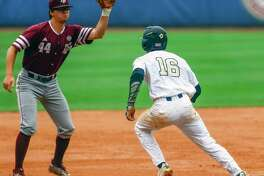 Texas A&M infielder George Janca (44) catches a throw to tag Vanderbilt infielder Austin Martin (16) out in a rundown during the second inning of the Southeastern Conference NCAA college baseball tournament, Tuesday, May 22, 2018, in Hoover, Ala. (AP Photo/Butch Dill)