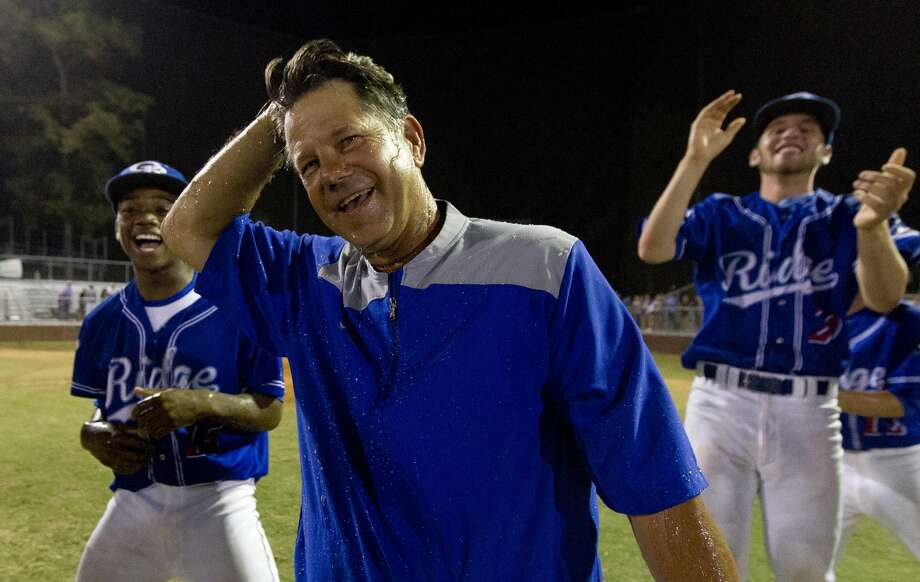 Oak Ridge head coach Mike Pirtle reacts after players dumped water on him in celebration of his 600th career win following the team's 8-0 win over Montgomery in a District 12-6A high school baseball game, Friday, April 28, 2017, in Oak Ridge. Photo: Jason Fochtman/Houston Chronicle