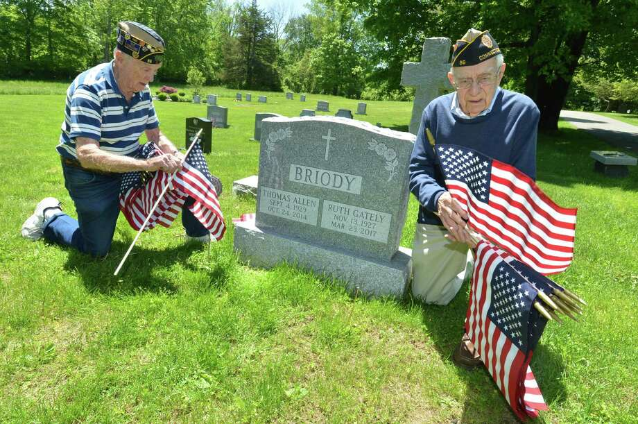 Bing Ventres, Commander Emeritus and Judd Mott, Vice Commander Emeritus of American Legion Post 86 place flags on the grave of Tom Briody, a veteran and post member at Hillside Cemetery on Monday May 21, 2018 in Wilton Conn. The Legion post buys and places more than 600 flags on the graves of Wilton's fallen veterans in the towns 5 cemeteries to honor them for the upcoming Memorial Day holiday and parade Photo: Alex Von Kleydorff / Hearst Connecticut Media / Norwalk Hour