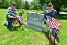 Bing Ventres, Commander Emeritus and Judd Mott, Vice Commander Emeritus of American Legion Post 86 place flags on the grave of Tom Briody, a veteran and post member at Hillside Cemetery on Monday May 21, 2018 in Wilton Conn. The Legion post buys and places more than 600 flags on the graves of Wilton's fallen veterans in the towns 5 cemeteries to honor them for the upcoming Memorial Day holiday and parade