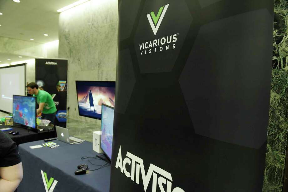 Employees of Vicarious Visions set up their display for a technology expo at the Legislative Office Building on Tuesday, May 22, 2018, in Albany, N.Y.   (Paul Buckowski/Times Union) Photo: PAUL BUCKOWSKI, Albany Times Union / (Paul Buckowski/Times Union)