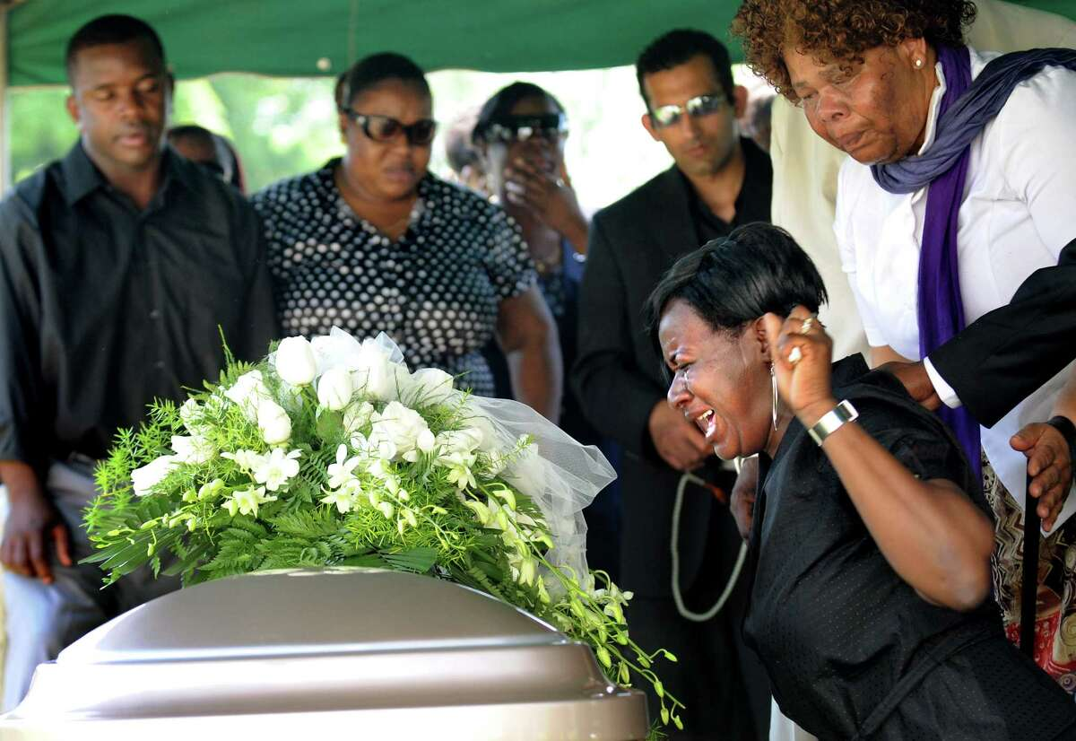 Shondell McAllister, right, cries over the casket of her daughter, Kathina Thomas, on Tuesday, June 10, 2008, at Graceland Cemetery in Albany, N.Y. Family and friends gathered to remember Kathina, who was gunned down in the West Hill neighborhood.