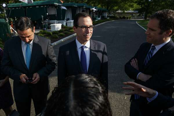 Treasury Secretary Steve Mnuchin talks with reporters about trade with China outside of the White House, Monday, May 21, 2018, in Washington. (AP Photo/Evan Vucci)
