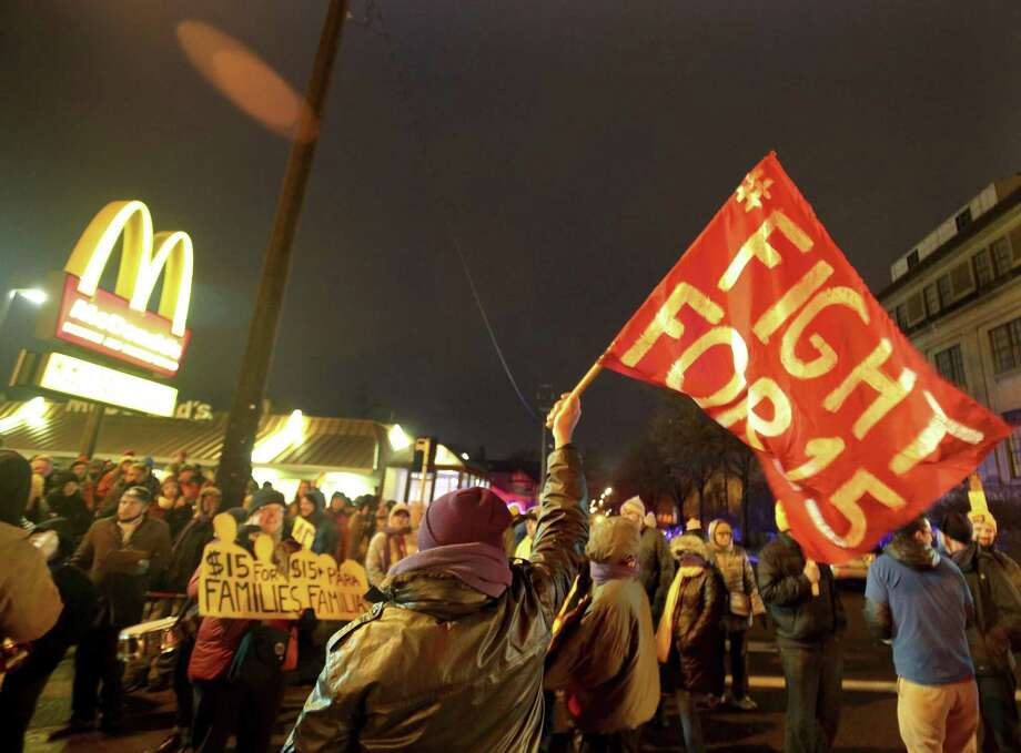 In this Nov. 29, 2016 photo, protesters gather outside a McDonald's restaurant in Minneapolis during a demonstration for higher wages as part of the National Day of Action to Fight for $15. On Tuesday, May 22, 2018, Fight for $15 is announcing that its helping women in several U.S. cities to file complaints with the U.S. Equal Employment Opportunity Commission alleged they experienced sexual harassment while working at McDonalds. Photo: Joles, David /Associated Press / David Joles