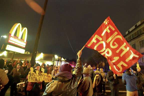 In this Nov. 29, 2016 photo, protesters gather outside a McDonald's restaurant in Minneapolis during a demonstration for higher wages as part of the National Day of Action to Fight for $15. On Tuesday, May 22, 2018, Fight for $15 is announcing that its helping women in several U.S. cities to file complaints with the U.S. Equal Employment Opportunity Commission alleged they experienced sexual harassment while working at McDonalds.