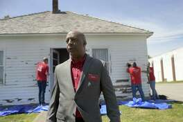 In this April 18, 2017, photo, Marvin Ellison, CEO of J.C. Penney Co., visits the boyhood home of the company's founder James Cash Penney in Hamilton, Mo. J.C. Penney's CEO is leaving the company to become the top executive at Lowe's. The announced departure of Ellison on Tuesday, May 22, 2018, sent shares of the besieged department store tumbling more than 12 percent to what may become an all-time low.