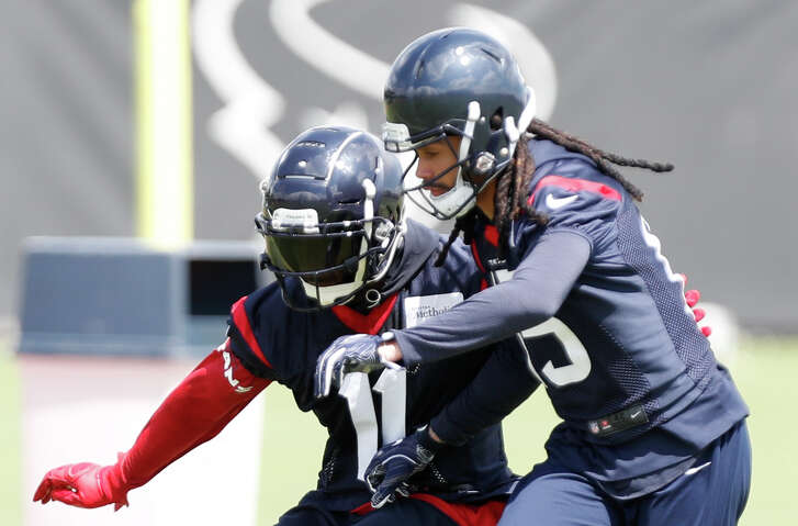 Houston Texans wide receiver DeAndrew White (11) and Will Fuller V (15) run a drill during Organized Team Activities at The Methodist Training Center on Tuesday, May 22, 2018, in Houston. ( Brett Coomer / Houston Chronicle )