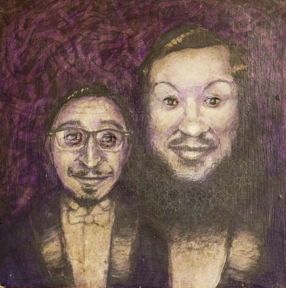 A painting of Stephen, left, and Fred Garza-Guzman hangs in the couple's home. The painting has recessed eyes that appear to follow people as they walk around the room.