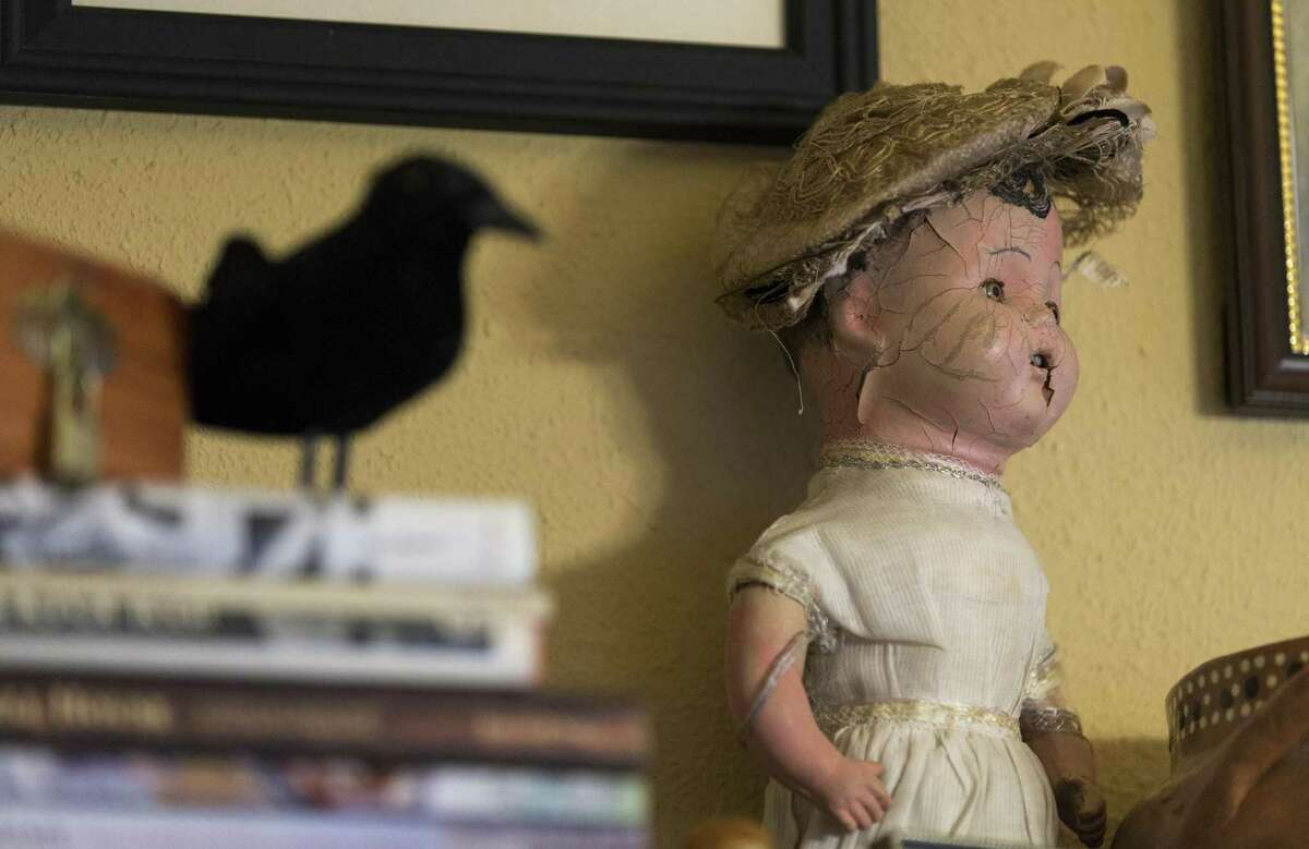 A doll supposedly haunted sits on a shelf in their home. The Garza-Guzmans say they own several paranormal-connected dolls among their large collection.