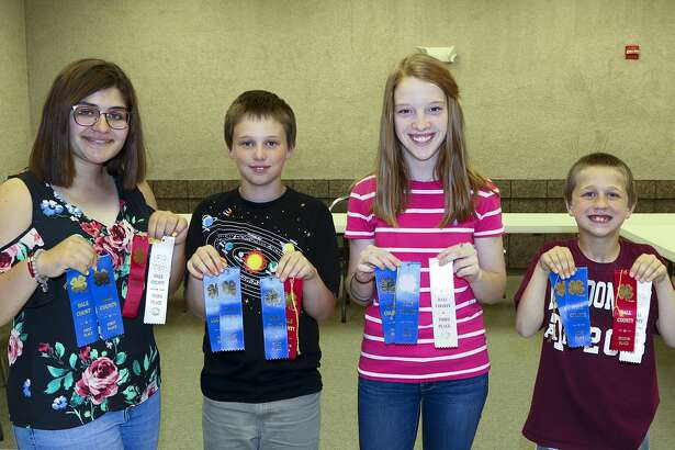 There were plenty of blue ribbons accumulated by participants of Hale County's 4-H photography contest. Participants include Jadyn Halencak (left), senior division; Hagen Pate and Campbell Offield, Intermediate Division; and Colson Pate, Junior Division. Connie Barnett was team coach.
