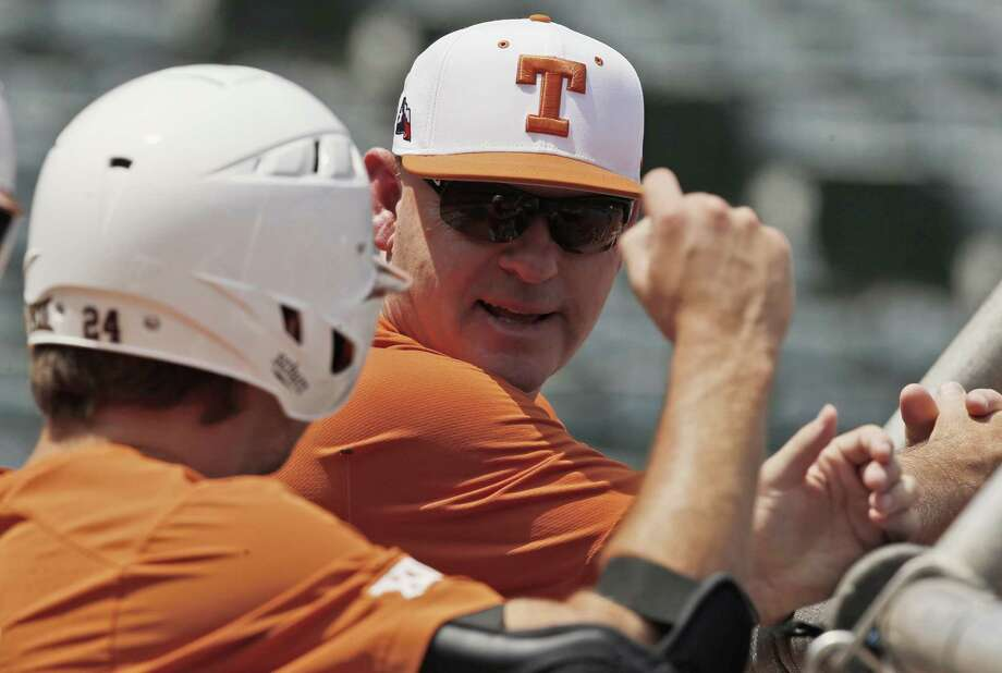 Texas head coach David Pierce, right, talks with pitcher Chase Shugart, left, during batting practice before the Big 12 Baseball Tournament in Oklahoma City, Tuesday, May 22, 2018. Texas is seeded number one in the tournament. (AP Photo/Sue Ogrocki) Photo: Sue Ogrocki, STF / Associated Press / AP2018