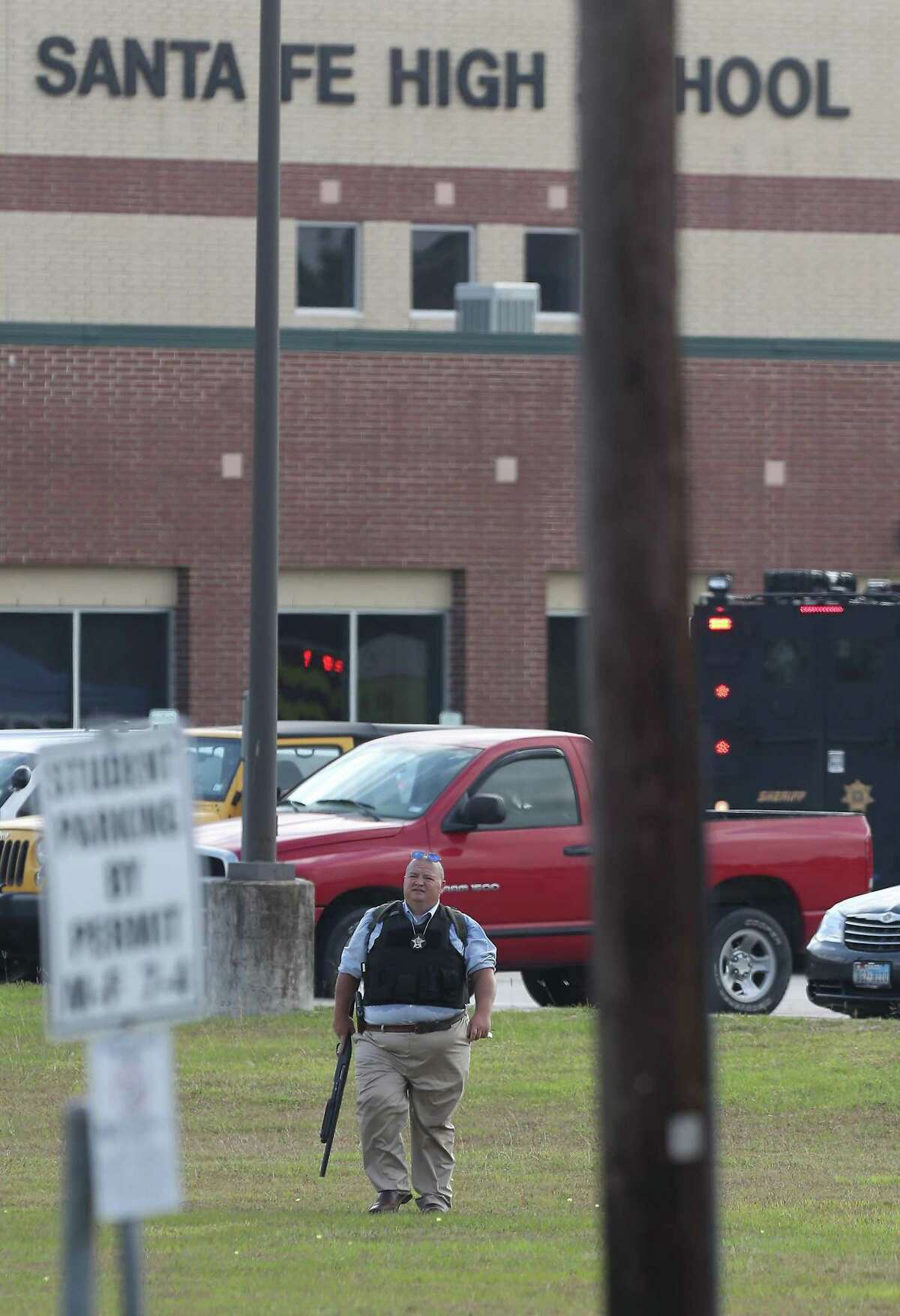 A law enforcement officer leaves Santa Fe High School in May 2018, when police say a student shot and killed 10 people at the campus. Many school districts have increased their police presence and safety measures at campuses in the wake of numerous school shootings in recent years.