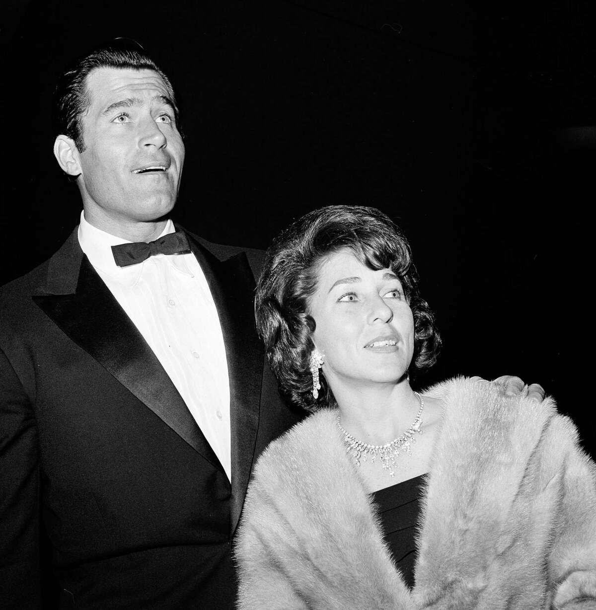 """FILE - In this June 20, 1963 file photo, actor Clint Walker and his wife arrive for the premiere of """"Cleopatra"""" in Los Angeles. Walker, who played the title character in the early TV western """"Cheyenne,"""" died Monday, May 21, 2018, of congestive heart failure at a hospital in Grass Valley, Calif. He was 91."""