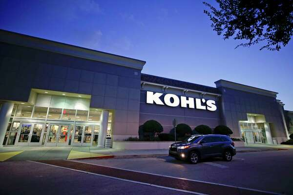 FILE- In this Aug. 22, 2017, file photo, a car drives by the entrance of a Kohl's department store in Orlando, Fla. Kohl's Corp. reports earnings on Tuesday, May 22, 2018. (AP Photo/John Raoux, File)