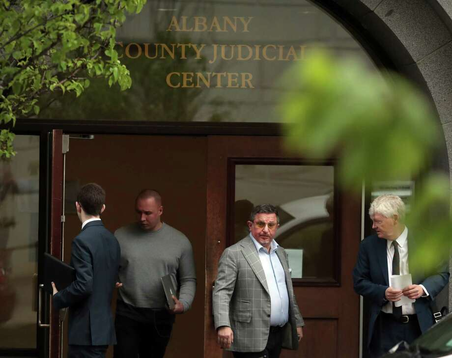 Evgeny Freidman, center, leaves court after pleading guilty and promising his cooperation in state and federal investigations, in Albany, N.Y., May 22, 2018. A significant business partner of Michael Cohen, President Trump's personal lawyer, Freidman has quietly agreed to cooperate with the government as a potential witness, a development that could be used as leverage to pressure Cohen to work with the special counsel examining Russian interference in the 2016 presidential election. Photo: NATHANIEL BROOKS, New York Times / NYTNS