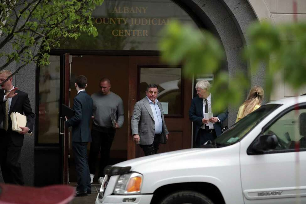 Evgeny Freidman, center, leaves court after pleading guilty and promising his cooperation in state and federal investigations, in Albany, N.Y., May 22, 2018. A significant business partner of Michael Cohen, President Trump's personal lawyer, Freidman has quietly agreed to cooperate with the government as a potential witness, a development that could be used as leverage to pressure Cohen to work with the special counsel examining Russian interference in the 2016 presidential election.