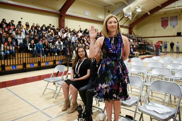 San Jose High School principal Gloria Marchant raises her hand as she is sworn in as a new US citizen during a naturalization ceremony held in the gym at San Jose High School in San Jose, CA, on Tuesday May 22, 2018.