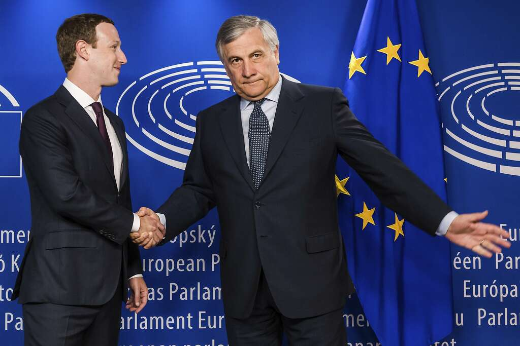 European Parliament President Antonio Tajani, right, welcomes Facebook CEO Mark Zuckerberg upon his arrival at the EU Parliament in Brussels on Tuesday, May 22, 2018. Facebook CEO Mark Zuckerberg faces senior European Union lawmakers today to answer questions about a scandal over the alleged misuse of the data of millions of Facebook users. (AP Photo/Geert Vanden Wijngaert) Photo: Geert Vanden Wijngaert / Associated Press