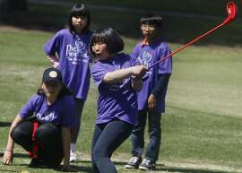 Students from Francis Scott Keys elementary including Joyce Mok (front), 11 years old, learning to play golf at Harding Park Golf course in San Francisco, Calif.,  on Monday, May 7, 2012.  They are participating in The First Tee,  a six week program delivered by PG&E to more the 300 SF elementary fifth grade students to teach core values and leadership skills by using the game of golf.