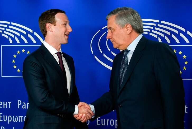 European Parliament President Antonio Tajani (R) welcomes Facebook CEO Mark Zuckerberg (L) at the European Parliament, prior to his audition on the data privacy scandal on May 22, 2018 at the European Union headquarters in Brussels.  / AFP PHOTO / JOHN THYSJOHN THYS/AFP/Getty Images