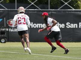 San Francisco 49ers defensive back Richard Sherman, right, and cornerback Ahkello Witherspoon (23) during NFL football practice at the team's training facility in Santa Clara, Calif., on Tuesday, May 22, 2018. (AP Photo/Tony Avelar)