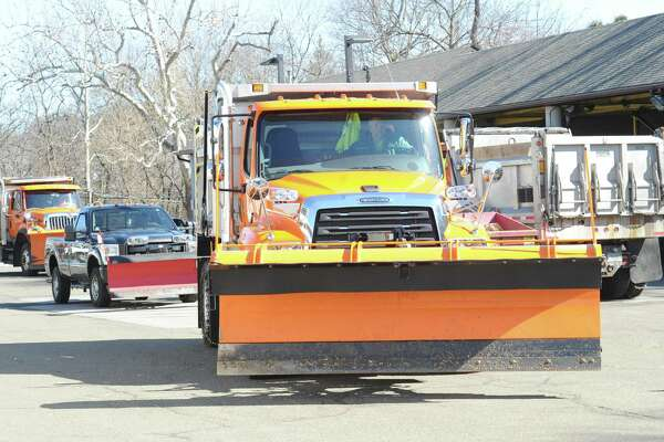 Greenwich Department of Public Works employees prepare vehicles in early March. The department is serving the town in a different way this week, by collecting donations for Neighbor to Neighbor.
