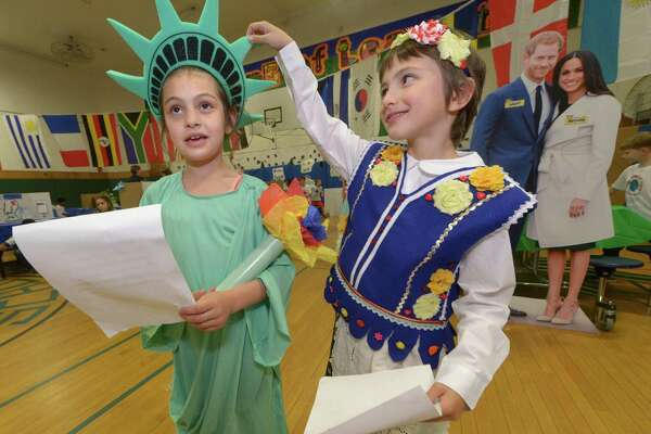 Amelia Rosenberg represents America and New York and Raven Bagnatti represents Poland as they prepare to give a welcome speech to the fifth grade during the 12th annual second grade All Around the World Culture Fair at Columbus Magnet School Tuesday, May 22, 2018, in Norwalk, Conn. Every year, Columbus second graders present personal research on their cultural backgrounds.