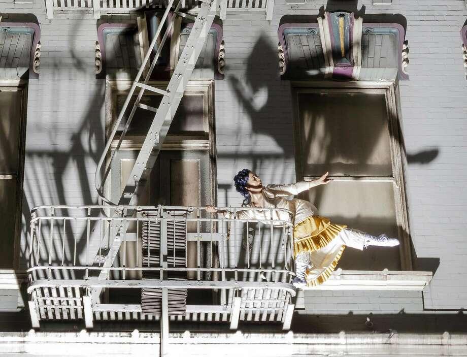 """Bianca Cabrera dances on a fire escape in a """"Tender"""" creation. Photo: RJ Muna"""