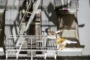 Bianca Cabrera dances on a fire escape in Flyaway Productions� �Tender.� Photo: RJ Muna.