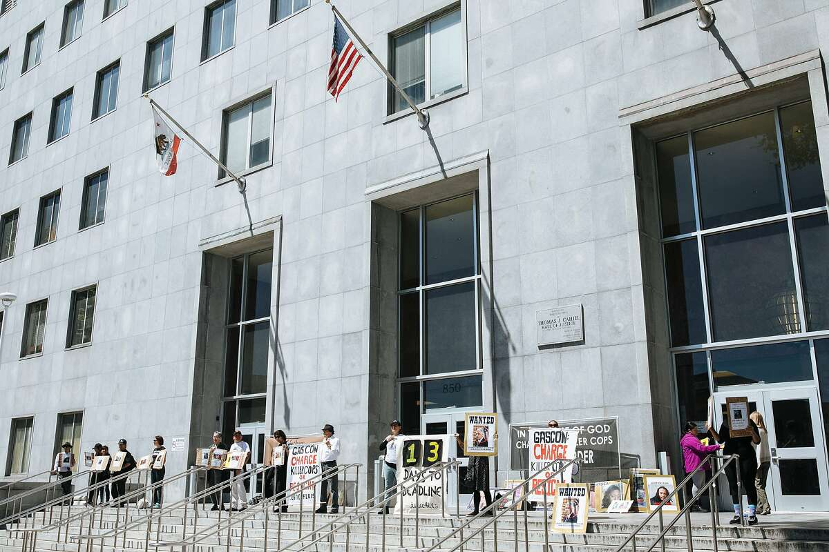 Protesters chant outside the Hall of Justice in protest of police shootings in San Francisco, Calif., Friday, April 13, 2018.