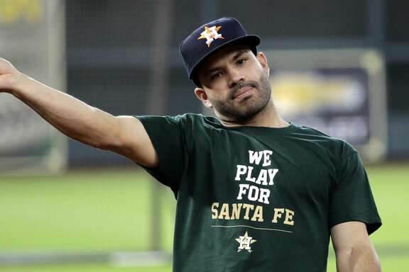 Houston Astros second baseman Jose Altuve throws during batting practice before a baseball game against the San Francisco Giants, Tuesday, May 22, 2018, in Houston. The Astros are wearing shirts showing their support for the Santa Fe High School shooting victims. (AP Photo/David J. Phillip)