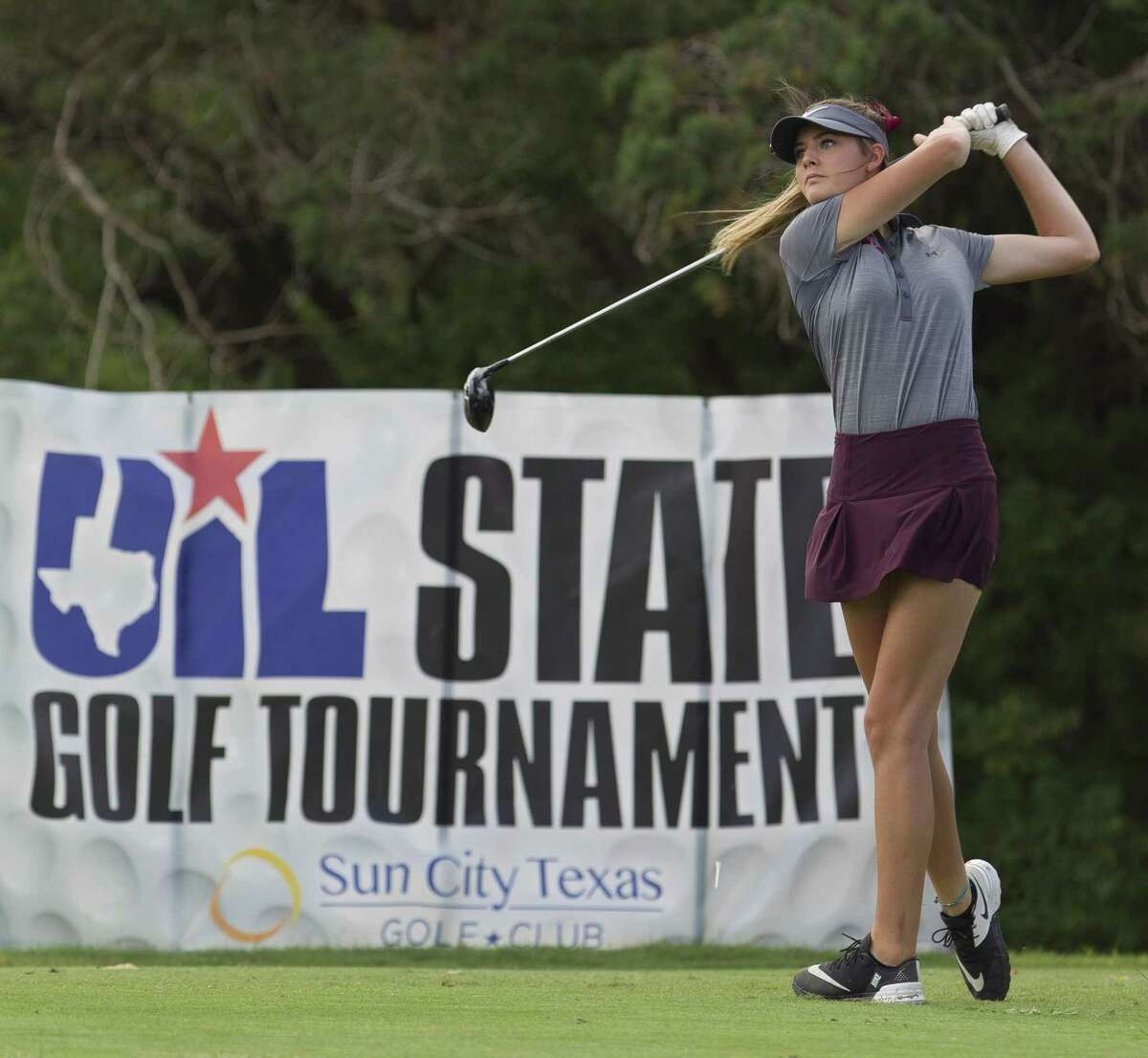 Kaydee Lowe of Magnolia hits off the first tee box during the final round of the Class 5A UIL State Golf Championships at White Wing Golf Club, Tuesday, May 22, 2018, in Georgetown.