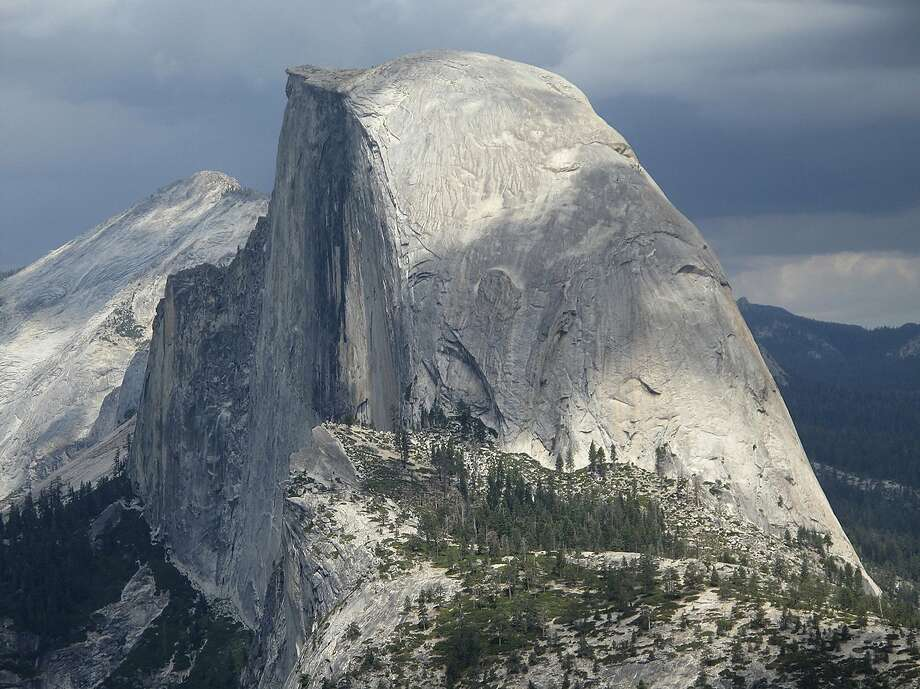 FILE - This August 2011 file photo shows Half Dome and Yosemite Valley in a view from Glacier Point at Yosemite National Park, Calif. The national park announced changes to the reservation system ahead of the planned takedown of Half Dome's cables in October. Photo: Tracie Cone / Associated Press